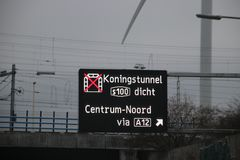 Dynamic route information panel warns for closed tunnel named Koningstunnel on S100 in The Hague on highway A4. Dynamic route information panel warns for closed royalty free stock photos