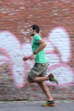 Dynamic Runner. A young man running fast and dynamic Stock Images