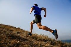 Dynamic running uphill Royalty Free Stock Photo
