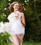 Dynamic running woman in green forest Royalty Free Stock Photography