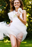 Dynamic sexy running woman in white dress Stock Images