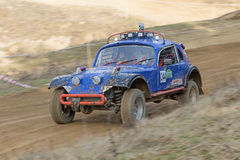 Dynamic shot of blue off road car in terrain Royalty Free Stock Photography