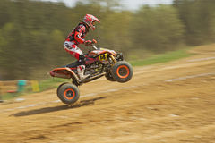 Dynamic shot of Quad racer jumping Stock Images