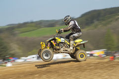 Dynamic shot of Quad racer jumping Royalty Free Stock Photo