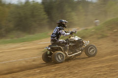 Dynamic shot of Quad racer riding Stock Photos