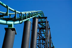 Roller Coaster Track. Dynamic shot of roller coaster track against a bright blue sky Royalty Free Stock Photography