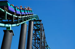 Roller Coaster Track. Dynamic shot of roller coaster track against a bright blue sky Royalty Free Stock Images