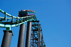 Roller Coaster Track. Dynamic shot of roller coaster track against a bright blue sky Stock Photos