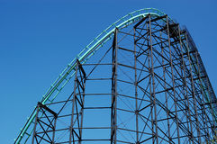 Roller Coaster. Dynamic shot of roller coaster track against a bright blue sky Royalty Free Stock Images