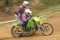 Dynamic shot of two racers ride a  sidecar Royalty Free Stock Image
