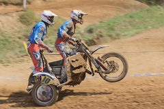 Dynamic shot of two racers standing on the sidecar Stock Image