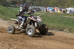 Dynamic shot of young quad rider Royalty Free Stock Image