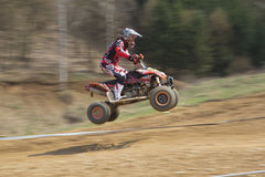 Dynamic shot of young racer jump Stock Photography