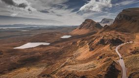 Dynamic sky over brown valley in mountain Quiraing, Scotland, United Kingdom, 4k, timelapse stock video footage