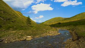 Dynamic sky over valley with a river in caucasus mountains, 4k, slow timelapse stock footage