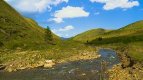 Dynamic sky over valley with a river in caucasus mountains, 4k, timelapse stock footage
