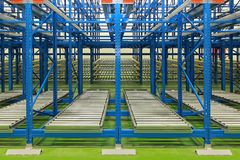 Dynamic storage system. Dynamic storage with conveyer rollers in new warehouse Royalty Free Stock Photo