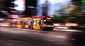 Dynamic Tram. Dynamic night riding yellow tram stock photos