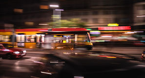 Dynamic Tram. Dynamic night riding yellow tram Stock Images