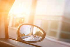Dynamic view from car on the wing mirror during drive. Sun shining. Transportation, travel, speed royalty free stock image