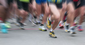Dynamic view of legs runner at starting. Zooming on legs runner at starting in panoramic view Stock Image
