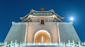 Dynamic Zoom / Crop Timelapse of the Chiang Kai Shek Memorial Hall at night with rising moon