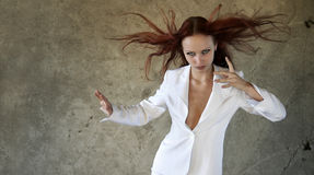 The dynamical beautiful girl h. Olding in her hand a charm Stock Photos