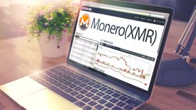 The Dynamics of Cost of MONERO on theLaptop Screen. Cryptocurren stock image