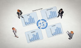 Dynamics of growth in business. Top view of business people and graphs and diagrams on floor Royalty Free Stock Photo