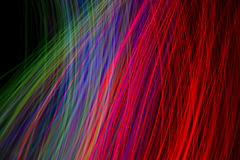 Dynamische farbige Lichter Bokeh auf schwarzem Hintergrund Lizenzfreie Stockbilder