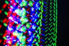 Dynamische farbige Lichter Bokeh auf schwarzem Hintergrund Lizenzfreies Stockbild