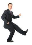 Dynamische zakenman in een zwart kostuum Stock Foto's