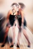Dynamiska magiska flickor i klänning Arkivfoto