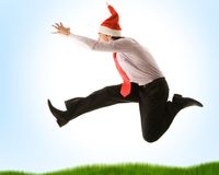 Dynamism. Very joyful businessman jumping high while stretching his arm forwards Royalty Free Stock Photos
