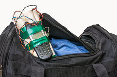 Dynamite bomb with phone in terrorist bag. Isolated on white background Royalty Free Stock Photos