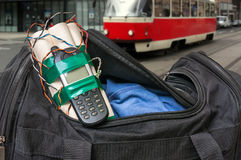 Dynamite bomb with phone in terrorist bag on street of city. Terrorism concept Stock Photo