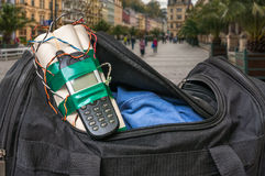 Dynamite bomb with phone in terrorist bag on street of city. Terrorism concept Stock Photos