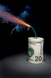 Dynamite cash with lit fuse Royalty Free Stock Photos