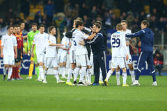 Dynamo Kyiv playes and coaches celebrating the victory in UEFA Europa League Round of 16 second leg match between Dynamo and Evert stock photography