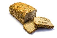 Dyniowego ziarna chleb pokrajać †‹â€ ‹na białym tle obraz stock