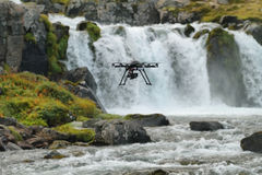 Dynjandi waterfall. Little quadcopter fliyng around Dynjandi waterfall in Westfjords, Iceland Royalty Free Stock Photo