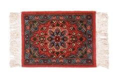 Dyrbar persisk matta på vit bakgrund Royaltyfria Foton