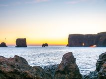 Dyrholaey arch with hole in evening of Iceland. Dyrholaey arch, mean `the hill island with the door hole`, amazing geology viewpoint near Vik town at south of royalty free stock photo