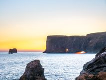 Dyrholaey arch with hole in evening of Iceland. Dyrholaey arch, mean `the hill island with the door hole`, amazing geology viewpoint near Vik town at south of royalty free stock photography