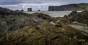 Dyrholaey. A black sand beach in south Iceland stock images