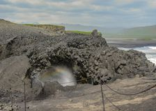 Dyrholaey cliffs and rainbow, South Iceland, Europe stock image