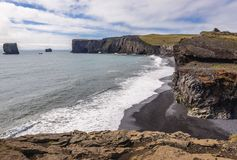 Cape Dyrholaey in Iceland. Dyrholaey foreland located on the south coast of Iceland, view from Kirkjufjara beach stock photo