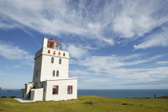 Dyrholaey lighthouse, Iceland. Lighthouse building at Dyrholaey cap in South part of Iceland royalty free stock photo