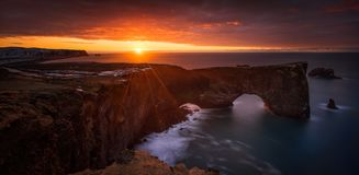 Dyrholaey dawn Panorama. Panorama of beautiful sunrise over Dyrholaey cliffs and rocky arch, Iceland royalty free stock image