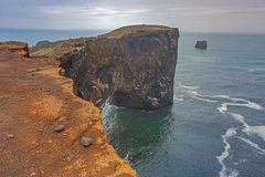 Dyrholaey promontory, Iceland. Dyrholaey, a lava rock promontory in southern Iceland royalty free stock photo